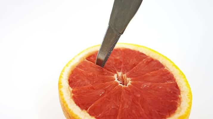 Grapefruit-knife-cutting-down-membrane-of-flesh