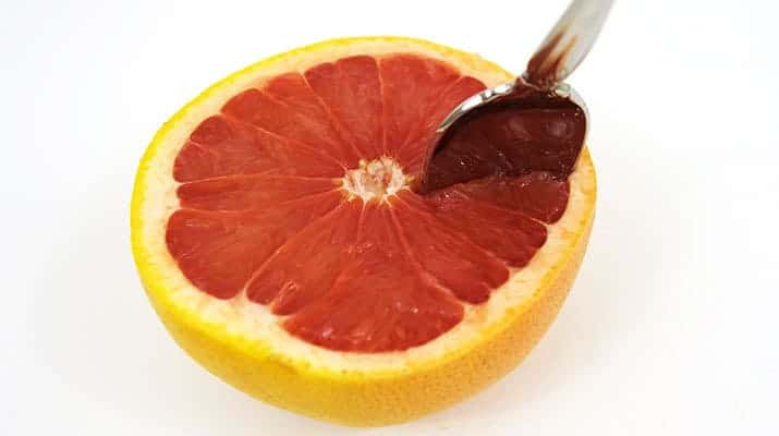 Cutting along the membrane of a grapefruit with a spoon