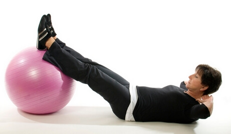senior woman fitness exercise sit ups with core training ball